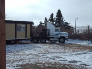 Mobile home being moved in winter