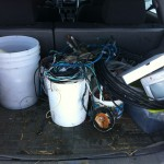 A picture showing copper wire in pails in the back of my car